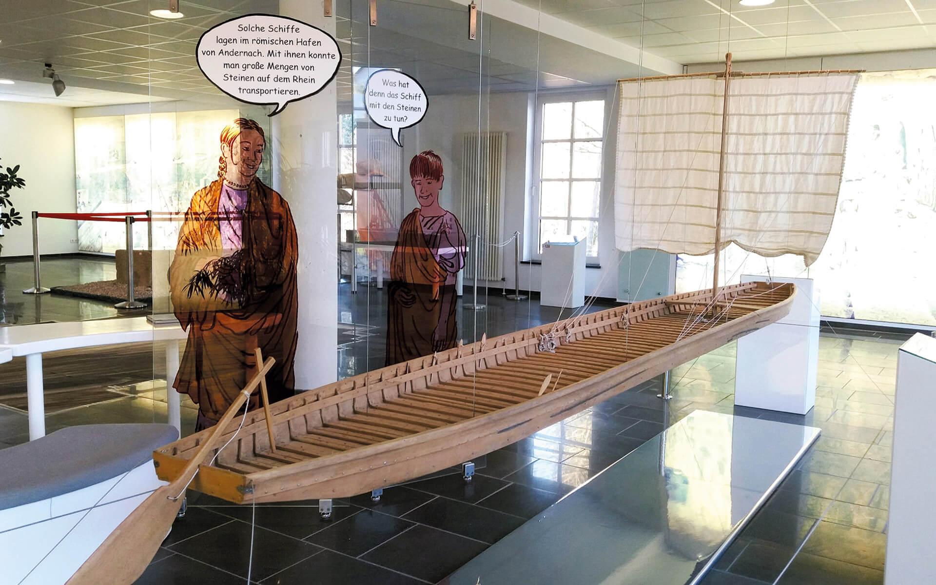 Vulkanpark, Infozentrum. Mit dem Plattbodenschiff (Phram) wurden Steine auf dem Rhein transportiert.